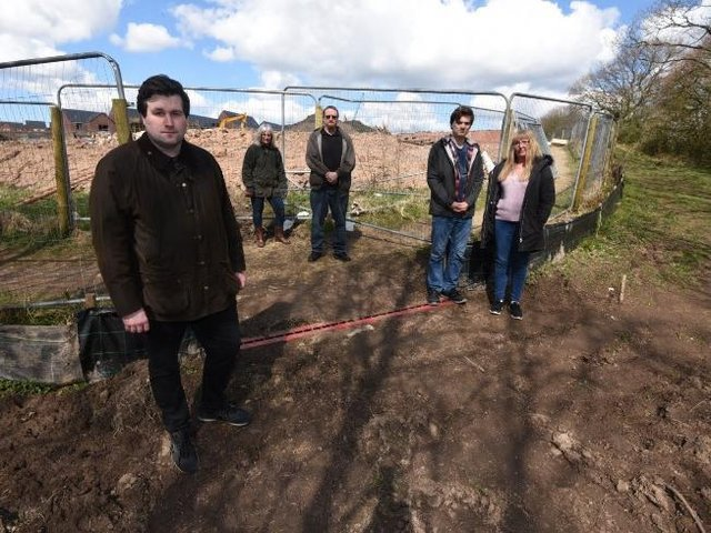Residents, from left, Adam Marsh, Jo Gregory, Stuart McGivern, Martin Kinsella and Andrea Kinsella angered by the path closure
