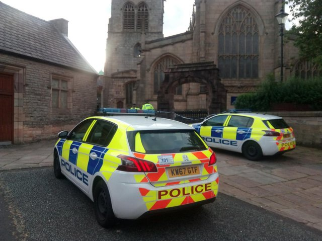 Police at the scene of Wigan Parish Church in August 2020