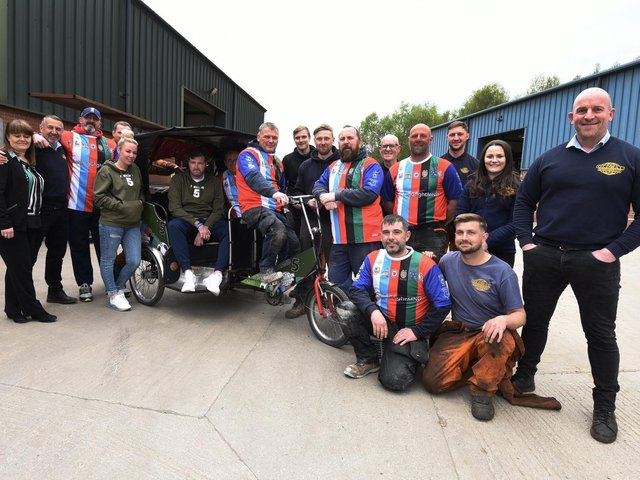 George Melling, in the rickshaw, with staff at Global Engineering who are preparing to travel 36 miles to Blackpool