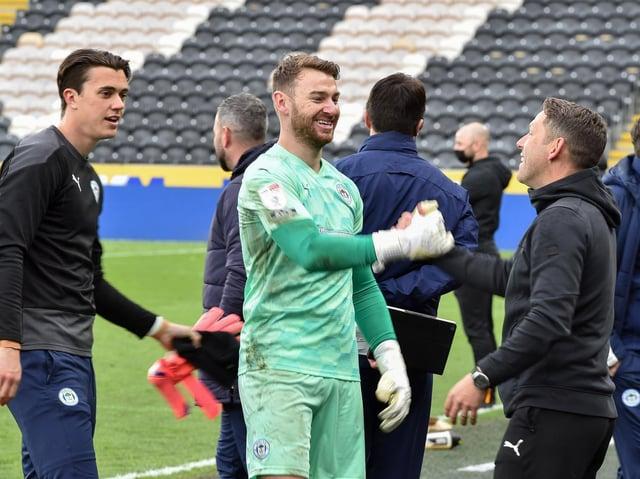 Jamie Jones leads the post-match celebrations