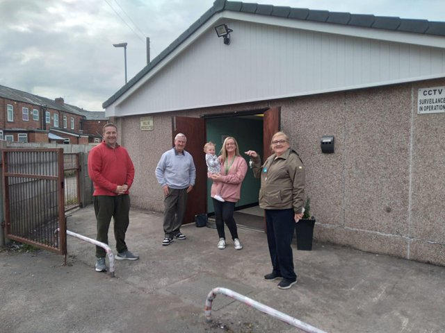 Coun Steve Jones (first left) with volunteers outside the new community centre