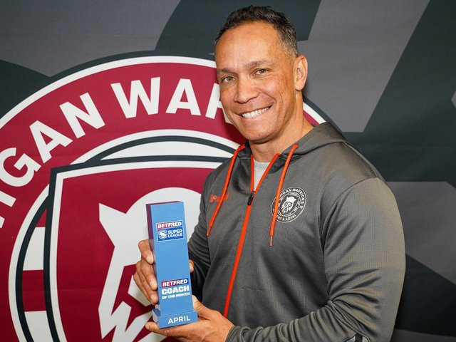 Adrian Lam with his Coach of the Month prize