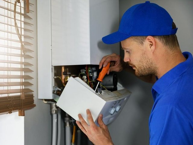 A boiler being maintained. Photo by Shutterstock