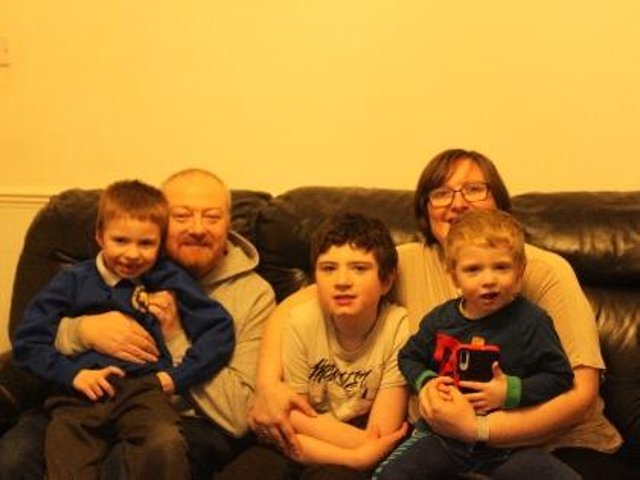 Dad  Andrew Perry  with sons Tom, Archie (centre) and Jack, and mum Louise
