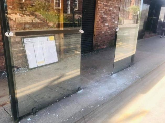 Damage caused to a bus shelter in Ashton town centre
