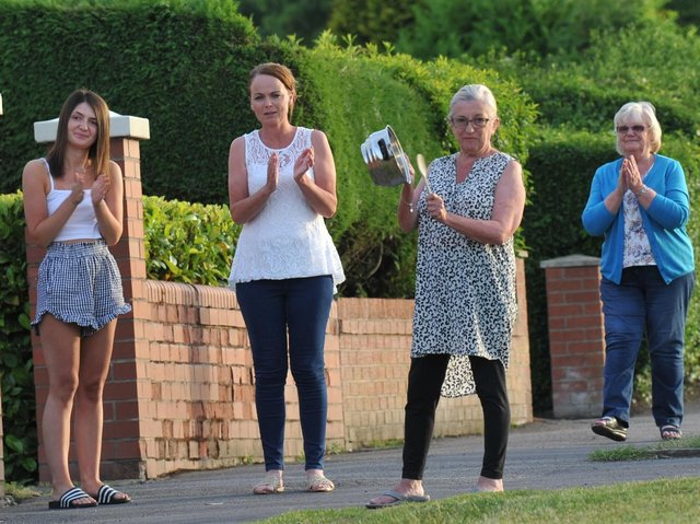 Residents on Winstanley Road, Pemberton, taking part in the clap for carers during the first national lockdown