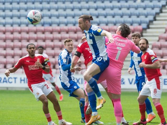 Will Keane heads for goal against Swindon