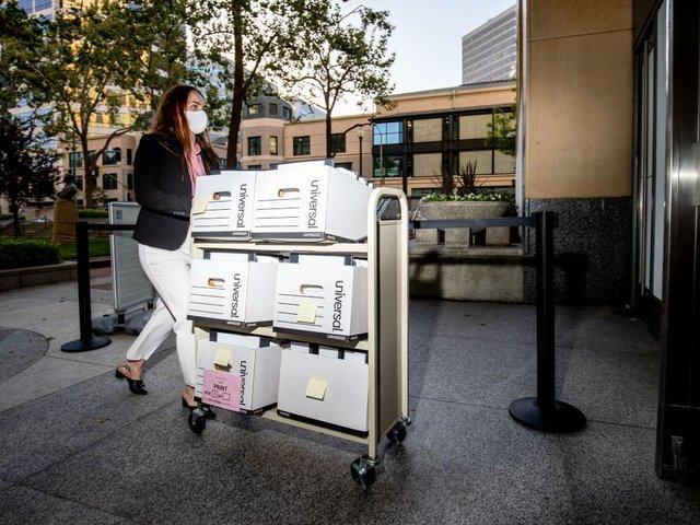 A member of the Epic Games legal team rolls a cart with documents while entering federal court on May 4, 2021 in Oakland, California.