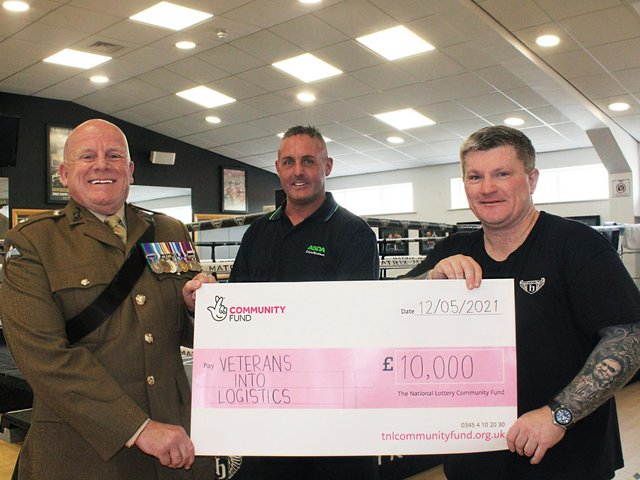 Ricky Hatton, right, presents the cheque to Wiganer Steve Eden and Major Ian Battersby, chairman of Veterans Into Logistics