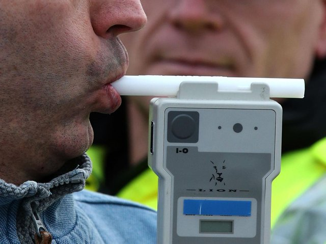 A drunken man drove at high speed around a village green with a flashing blue light in the window of his car
