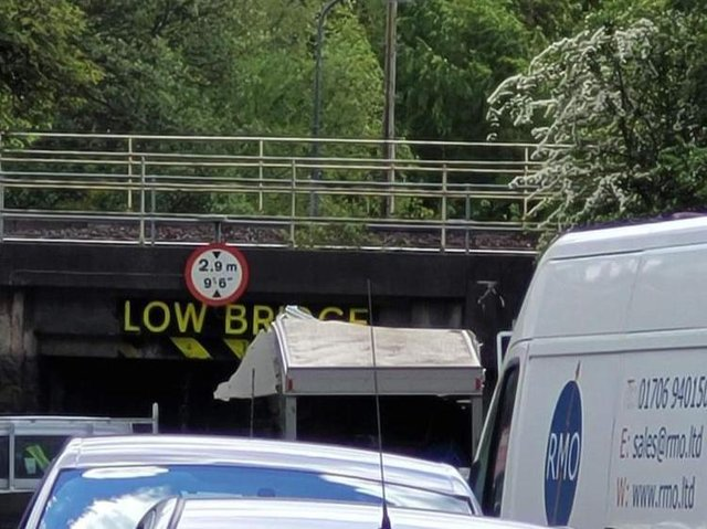 The van stuck beneath the low bridge on Prescott Street