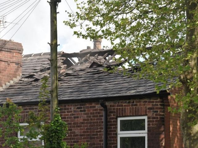 Damage to the roof of the house on Vine Street, Whelley