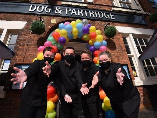 Staff prepare to welcome back customers to the Dog and Partridge in Wigan