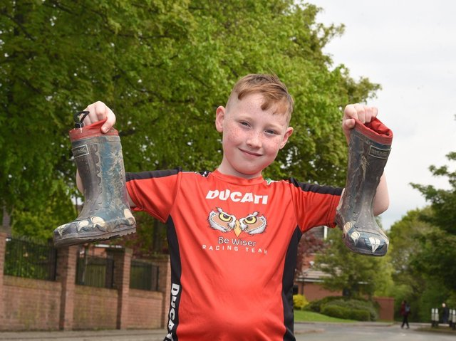 John-Joe Redford, nine, is taking on a 200km walking challenge over the month to raise funds for the neo-natal unit at Wigan Infirmary