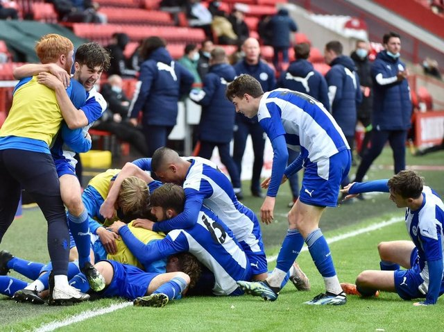The Latics starlets celebrate the match-clinching second goal at Charlton