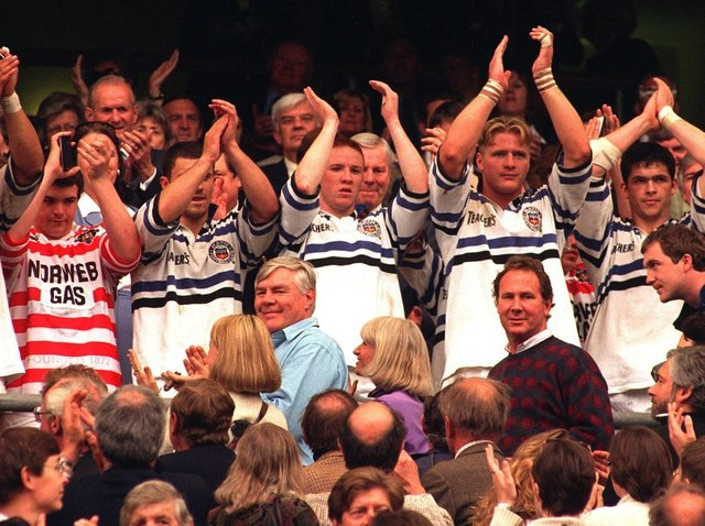 The Wigan team who had already changed shirsts with the Bath  players applaud  the fans