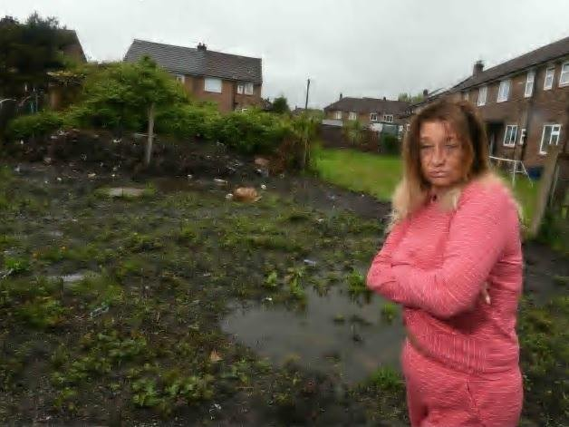Debbie Caveney has complained to the council about her back garden which floods and is in a state