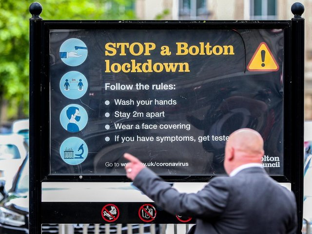 Coronavirus signage in Bolton town centre, one of the areas of the UK where the Covid variant first identified in India is spreading fastest