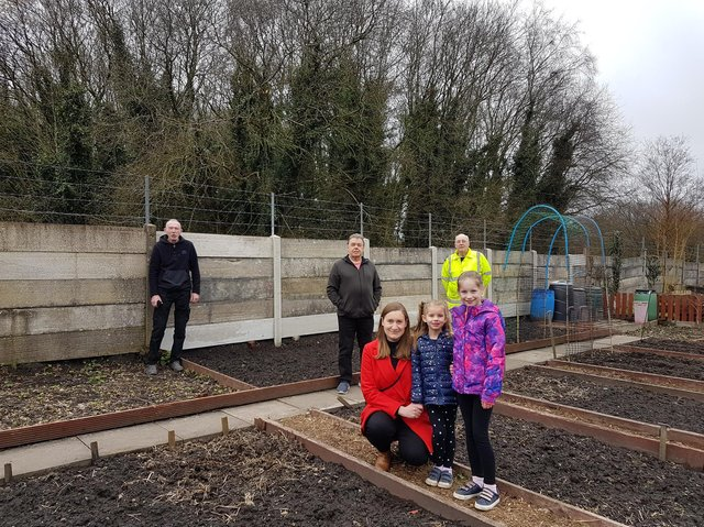 Coun Ron Conway (back middle) with Coun Laura Flynn (front) and members of New Springs Allotment Society