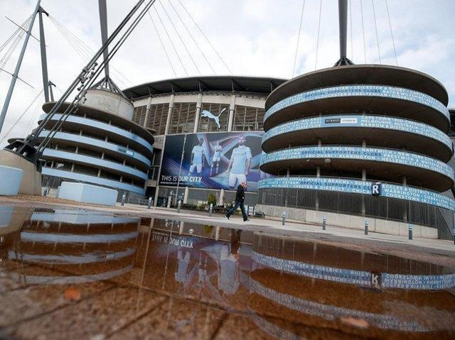 Burke was seen on TV making a monkey-gesture and noises towards three black players at the Etihad Stadium