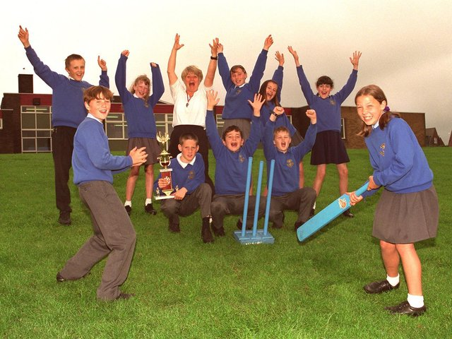 JUNE - 1997 - Howzat!  Kwik cricket kings St, Marie's RC Primary School, Standish, Year 6 pupils who have won the North of Wigan heat and now qualify for the Wigan tournament and further down the line a possible place in the finals at Old Trafford. Helping them celebrate is PE teacher, Linda Unsworth.