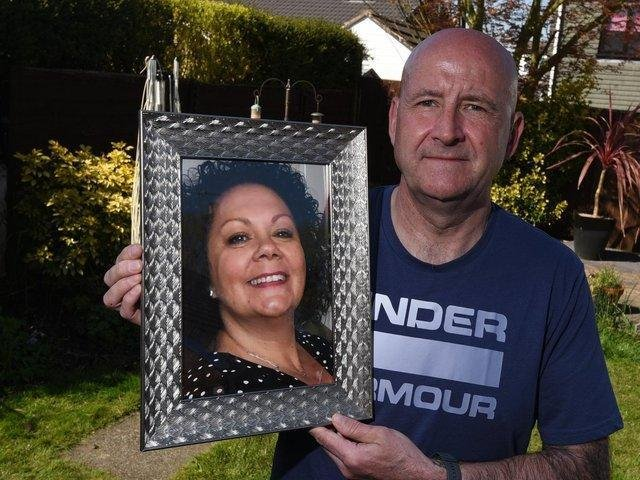 Ian Barlow, from Orrell, with a picture of his late wife Michelle