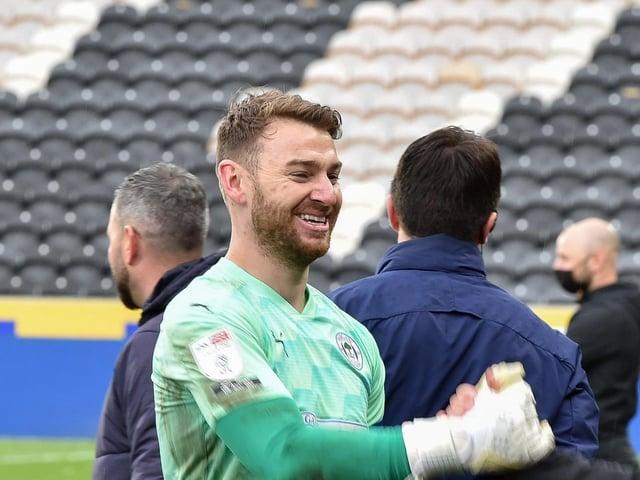 Jamie Jones celebrates after helping Latics avoid the drop