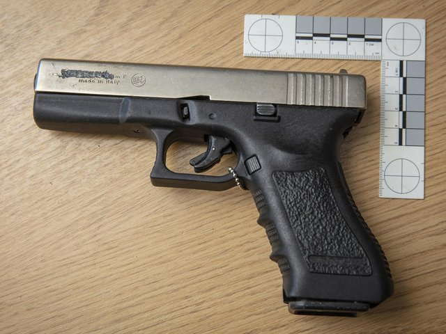 A converted top-venting imitation firearm
