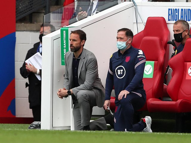 England's manager Gareth Southgate (L) and Steve Holland, Assistant Coach of England (R) 'take a knee' ahead of the international friendly football match between England and Romania at the Riverside Stadium in Middlesbrough.