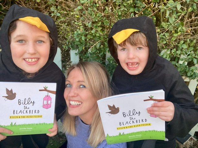 Jennifer Doyle with daughter Isabella and son Harry, holding up the Billy the Blackbird book