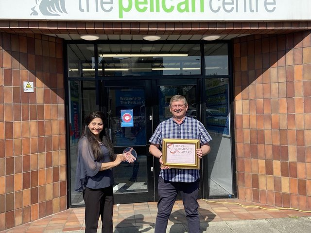 Coun Nazia Rehman presents the Heart of the Community award to Paul Costello