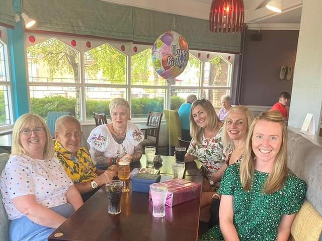 Eric Whitter celebrating his 77th birthday with friends