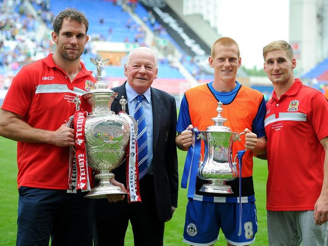Pat Richards on the pitch at the DW Stadium the day after winning the 2013 Challenge Cup, with Latics chairman Dave Whelan, FA Cup hero Ben Watson and Sam Tomkins