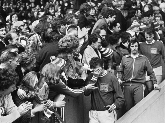 Consolation from the fans for upset Latics captain Albert Jackson followed by Graham Oates and Billy Sutherland as they come down with their runners-up medals after losing 2-1 in extra time to Scarborough in the FA Trophy final at Wembley on Saturday 28th of April 1973
