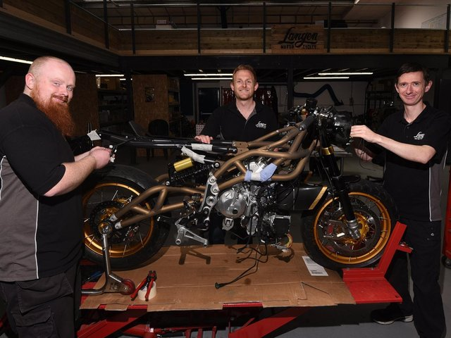 from left, Dan Ball, owner Christofer Ratcliffe and Andrew Naylor at Langen Motorcycles, bespoke motorbike factory