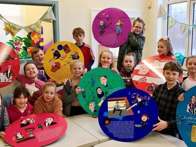Pupils from Sacred Heart Catholic Primary School with some of the plaques