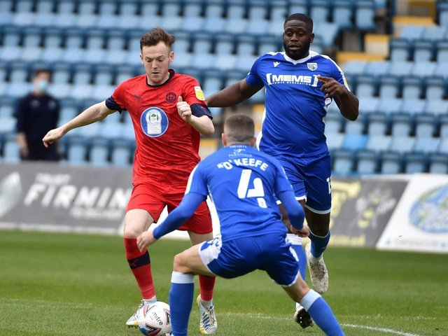 George Johnston in action for Latics