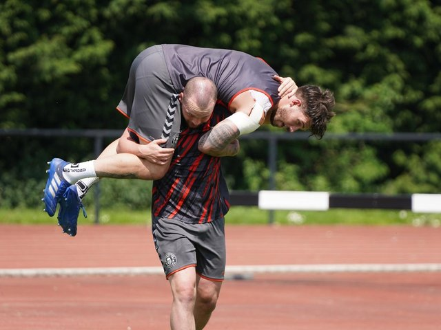 Liam Marshall carries Oliver Gildart in training