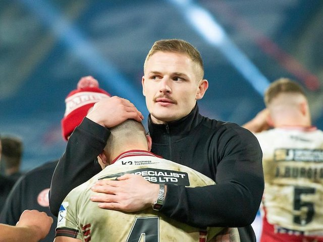 George Burgess comforts Oliver Gildart after the Grand Final