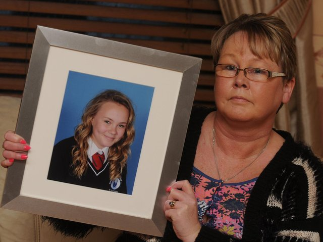 Diane Roberts with a photograph of daughter Jemma-Louise Roberts