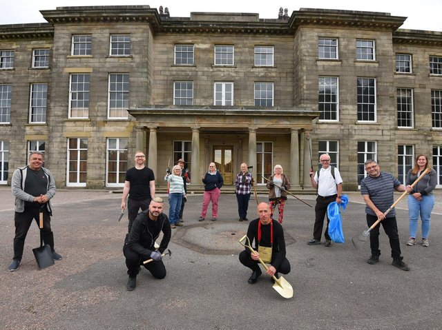 Volunteers get to work at Haigh Hall