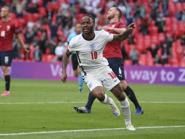 Raheem Sterling celebrates his early goal which settled the match against the Czech Republic