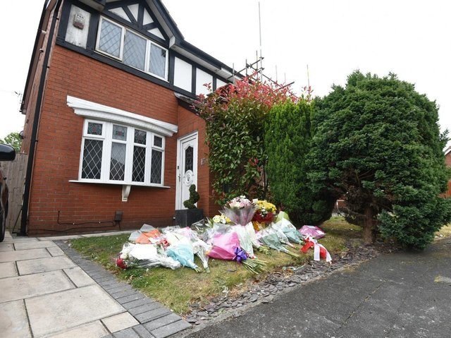 Flowers left at the scene of the fire in Poolstock