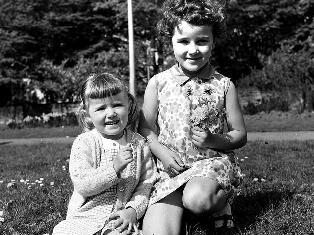 Sisters Alison and Katherine Walmsley enjoy one of Wigan's well kept parks in May 1970
