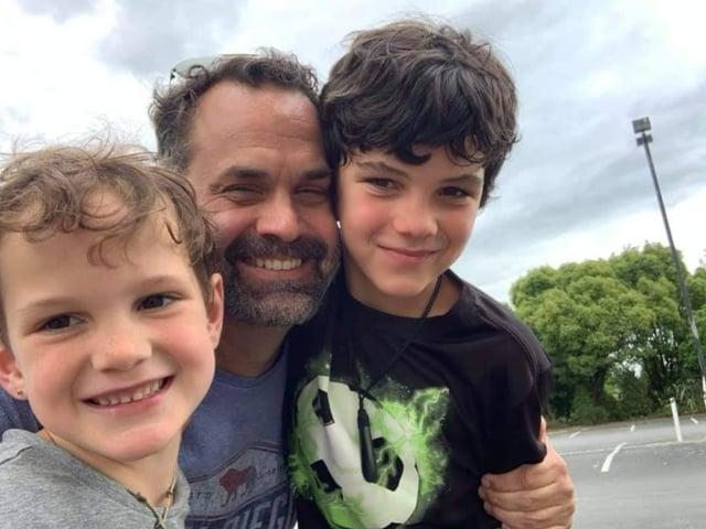 Chris with his children Wyatt, six, and Roark, 10