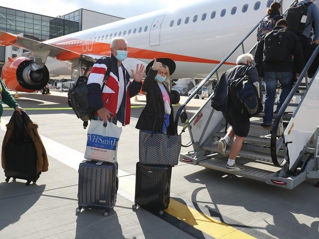Passengers prepare to board an easyJet flight to Faro, Portugal, at Gatwick Airport