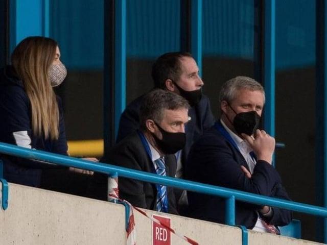 Dr Tom Markham (far right) watches last season's defeat at Gillingham