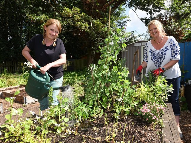 Jo Williams and Shelley Guest in the community garden