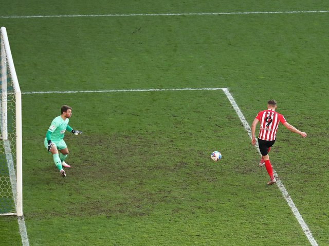Charlie Wyke scores against Latics for Sunderland at the end of last season