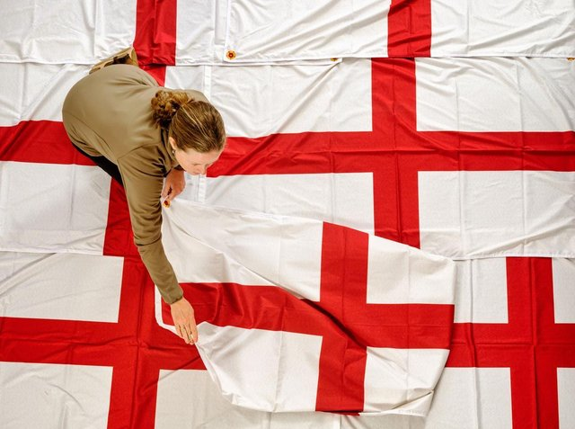 A member of staff preparing one of the specially designed St George's flags